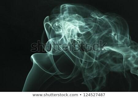 Purple smoke rises up on a black background. Stock photo © pxhidalgo