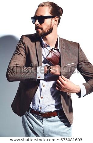 Mann · Sonnenbrillen · gut · aussehend · modernen · junger · Mann · isoliert - stock foto © feedough