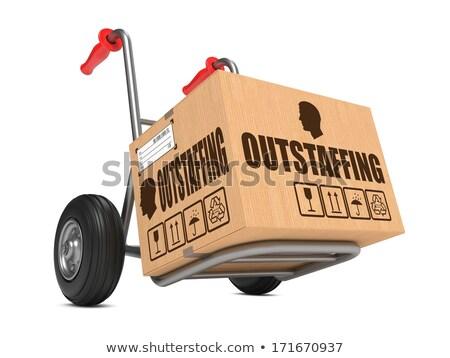 Outstaffing - Cardboard Box on Hand Truck. Stock photo © tashatuvango