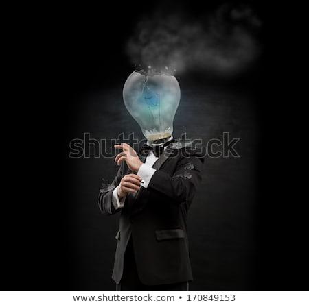 Túlhajszolt kiégés üzletember áll villanykörte fej Stock fotó © hasloo