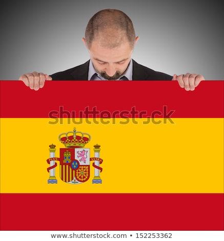 Spanish Businessman holding business card with Spain Flag Stock photo © stevanovicigor