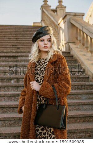 portrait of attractive blonde woman in animal print dress stock photo © user_6981622