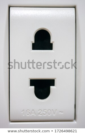 Closeup of electrical outlet, as man and woman connection concept on textured wall Stock photo © denisgo