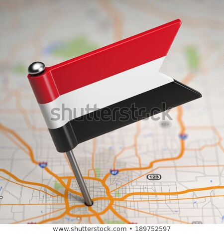 Yemen Small Flag on a Map Background. Stock photo © tashatuvango