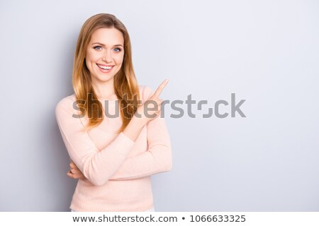 Happy blond woman with a beaming toothy smile Stock photo © dash