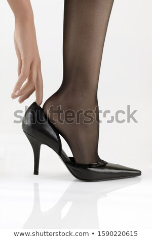 close up shot of young woman putting on stockings stock photo © elisanth