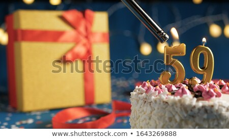 birthday cake with burning candle number 59 stock photo © zerbor