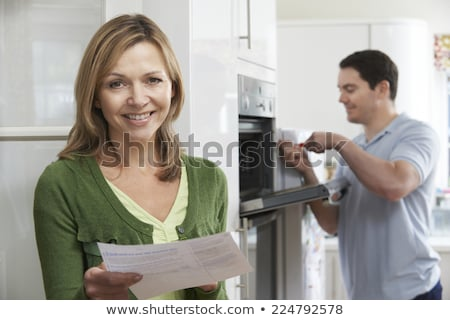 Satisfied Female Customer With Oven Repair Bill Stock photo © HighwayStarz