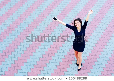 full-length shot of a happy beautiful businesswoman in formal dress outdoors Stock photo © deandrobot