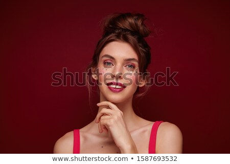 Woman with Burgundy Hair Looking at Camera Stock photo © stryjek