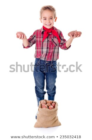 Happy little agriculturist boy showing potato harvest Stock photo © erierika