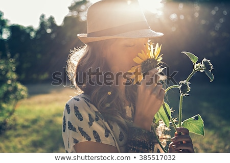 closeup portrait of a happy beautiful woman in spring garden stock photo © deandrobot