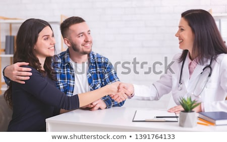 medical doctor and young couple patients stock photo © deandrobot