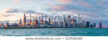 Sunset panorama of Chicago  Stock photo © benkrut