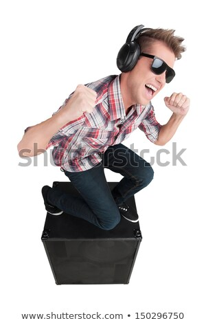 Young man with headphones, stading in a speaker Stock photo © hsfelix