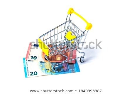 Shopping cart filled with euro coins on a white background Stock photo © Zerbor