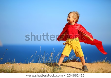 Boy dressed as a superman flying Stock photo © imagedb