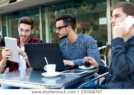 Stok fotoğraf: Outdoor Portrait Of Young Entrepreneurs Working At Coffee Bar