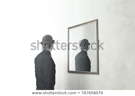 Man looking at his reflection in the mirror Stock photo © deandrobot