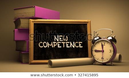 new competence   chalkboard with hand drawn text stock photo © tashatuvango