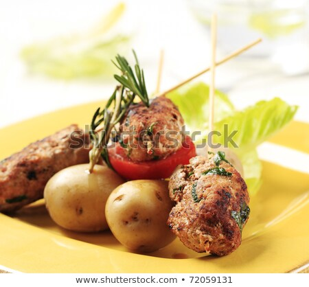 Minced meat kebabs and new potatoes Stock photo © Digifoodstock
