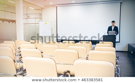 Serious speaker using laptop in empty boardroom Stock photo © deandrobot