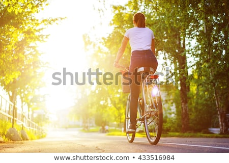 Happy girl with bike at park on sunny autumn day stock photo © cienpies