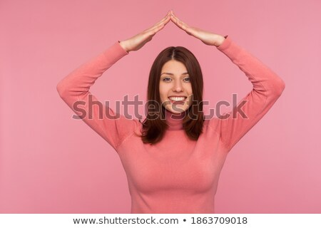 Brown haired woman thinks to herself and smiles Stock photo © dash