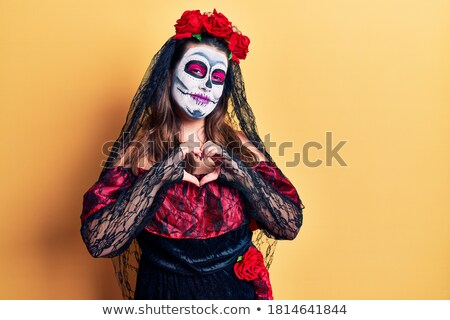 young smiling bride showing heart gesture with hands stock photo © deandrobot