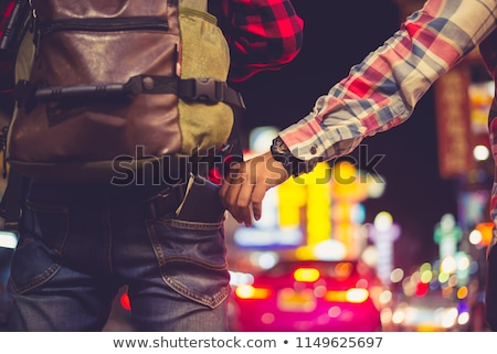 Pickpocket steals money cash from bag Stock photo © Filata