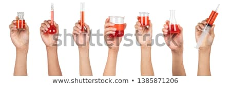 a hand holding a volumetric flask stock photo © bluering