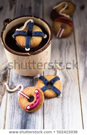 Kurabiye dekore edilmiş fincan kahve içmek Stok fotoğraf © faustalavagna