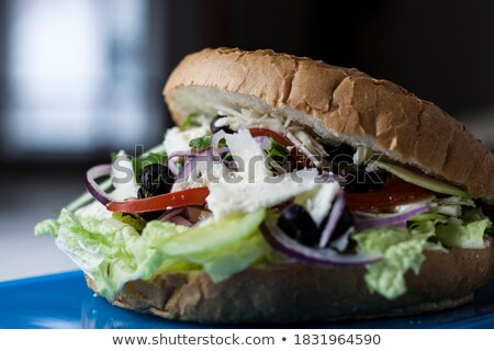 veggie burger with homemade olive bread and blurred vegetables Stock photo © faustalavagna