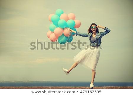 Mutlu genç kadın renkli lateks balonlar Stok fotoğraf © deandrobot
