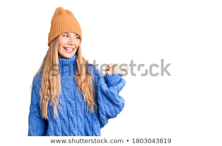 portrait of a young beauty wearing winter hat stock photo © konradbak