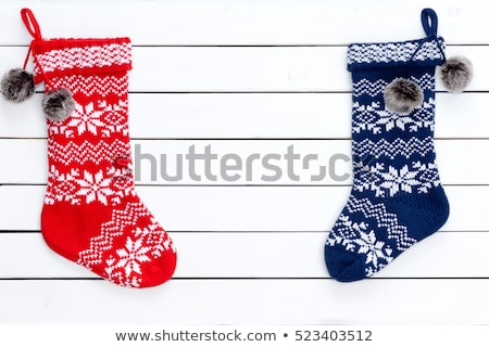 Couple colorful patterned Christmas stockings Stock photo © ozgur