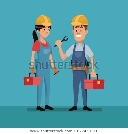 Female construction worker in a helmet with a perforator Stock photo © vlad_star