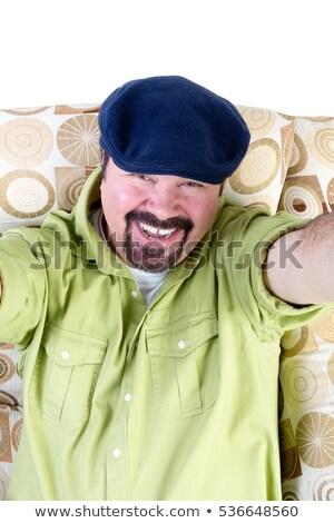 Risonho excesso de peso homem cadeira móvel boina Foto stock © ozgur