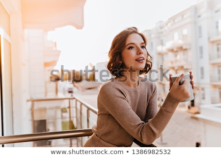 Foto stock: Woman Drinking Coffee Or Tea With Cup On The Balcony