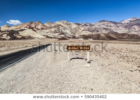 desert landscape narrow road and sign of the scenic artist drive stock photo © meinzahn