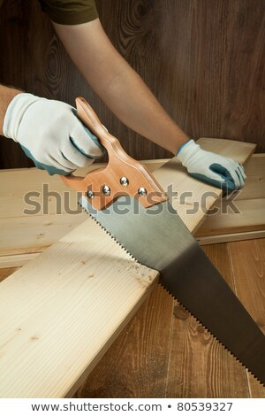 amrs of a woodworker cutting a plank stock photo © giulio_fornasar