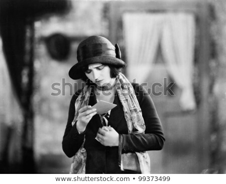 Woman reading letter and frowning Stock photo © monkey_business
