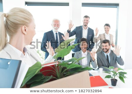 Cheerful young businessman waving her hand. stock photo © NikoDzhi