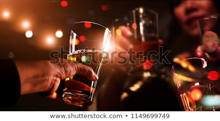 Thoughtful woman having a glass of whisky  Stock photo © wavebreak_media