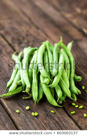 Fresh green beans on dark wooden rustic background Stock photo © yelenayemchuk