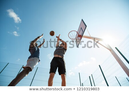 young african man play basketball outdoors stock photo © deandrobot