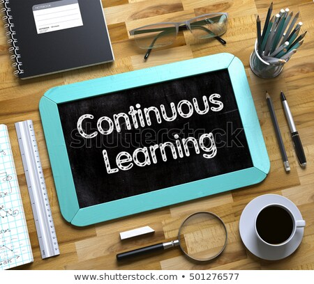 Small Chalkboard with Continuous Learning Concept. 3D. Stock photo © tashatuvango