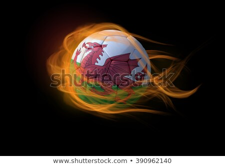 Football in flames with flag of wales Stock photo © MikhailMishchenko