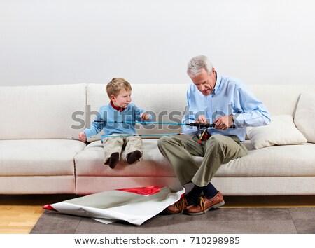мальчика деда новых удочка подарок диван Сток-фото © IS2
