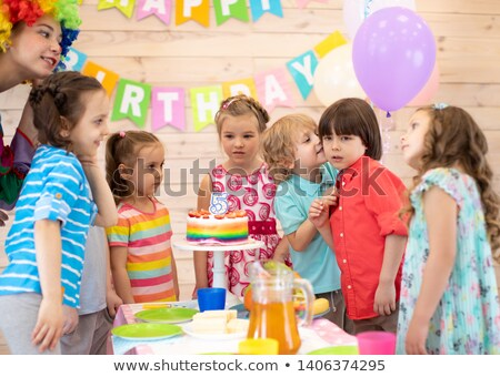 Girl whispers in boys ear at birthday Stock photo © IS2